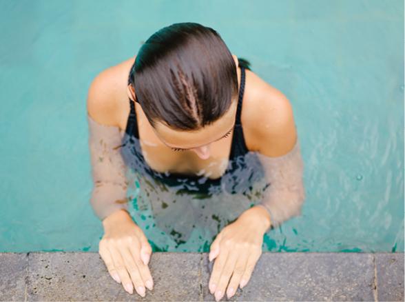 Lake & Wells Indoor Pool Woman at Edge