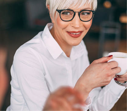 Lake & Wells Amenities Woman with Coffee